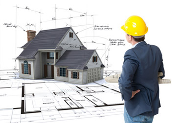 stock-photo-18087878-group-of-architects-working-on-a-project